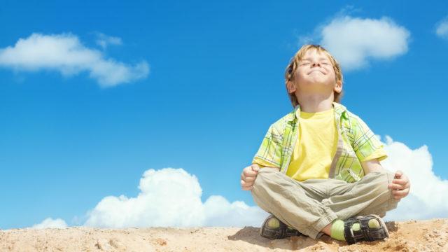 Happy Kid on a Sand Pile